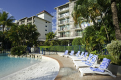 Large Lagoon Swimming Pool with Swim up Bar, Sun Beds and tropical gardens - Novotel Cairns Oasis Resort