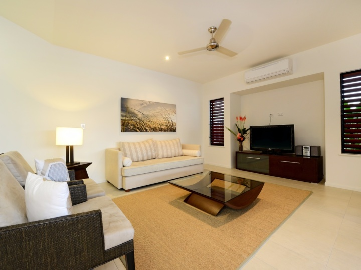Large Lounge Area with Flat Screen Television opening out to Timber Deck and Pool - Port Douglas Holiday House
