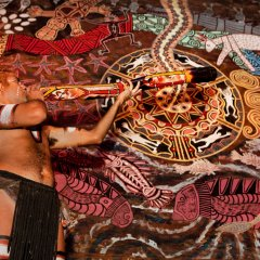 Learn how to make Aboriginal Cultural beads and tap sticks at Tjapukai Cultural Park in Cairns