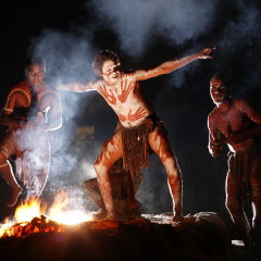 Listen to the haunting sounds of the didgeridoo as Aboriginals dance over fire