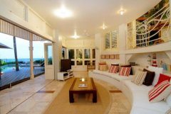 Living Room with bifold doors to Pool deck to allow the tropical air in - Luxury Port Douglas Holiday Home