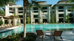 Relax by the lagoon swimming at Sea Temple Resort Palm Cove Private Apartments