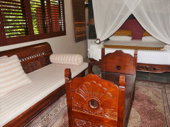 Lotus Deluxe Room Balinese inspired furnishings