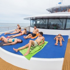 Lounging on Sun Deck onboard our Great Barrier Reef tour boat