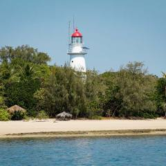 Low Isles Lighthouse Was Established In 1878 | Visit Low Isles On A Private Luxury Sailing Charter
