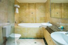 Luxurious Bathrooms with Spa at Seachange Beachfront Holiday Apartments Trinity Beach