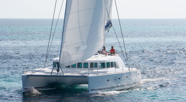 Luxury private charter catamaran sailing boat on Australia's Great Barrier Reef from Port Douglas