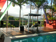 The Mountain Retreat Swimming Pool offers magnificent views across lush rainforests and mountains