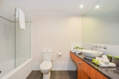 Main Bathroom with Shower over Bath - Alamanda Palm Cove Private Beachfront Apartment