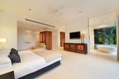 Master Bedroom complete with freestanding bath tub overlooking the wet edge pool and views beyond