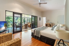 Master Bedroom on Top level with Balcony and views out to the Beach | Cairns' beachhouses