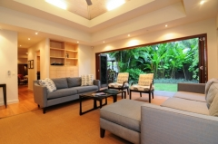 Media Room with bifold doors opening out to the lawn -  Port Douglas Holiday Home