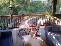 Mungumby Guest Lounge overlooking the Tropical pool and rainforest