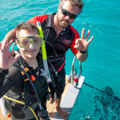 New Diver Learning Dive Signals On Board New Reef Vessel - Cairns