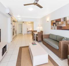 Apartment style accommodation with open plan dining and living area flowing out to balcony/patio - Oaks Lagoons Port Douglas