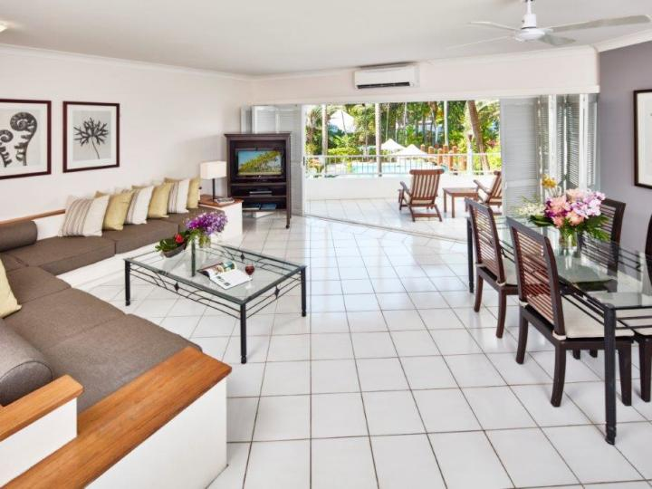 Spacious Living and Dining Areas with private Balcony - One Bedroom Poolview Suite - Alamanda Resort Palm Cove