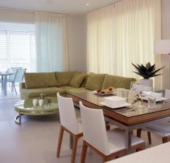 Open plan dining and living areas at 201 Lake St Holiday Apartments Cairns