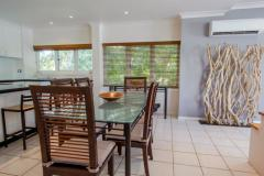 Open plan dining and living area - Alamanda Resort Palm Cove Fully Self Contained Holiday Apartment - Private Apartment 94