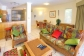 Open plan dining and lounge area - Coral Horizons Palm Cove Apartments with Ocean views