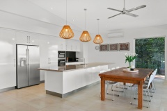Open plan gourmet kitchen and dining in your Cairns holiday home