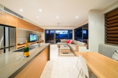 Open plan Kitchen, Living and outdoor dining - Port Douglas luxury accommodation
