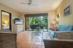 Open plan living area opening out to private balcony/patio - Villa San Michele Apartments Port Douglas