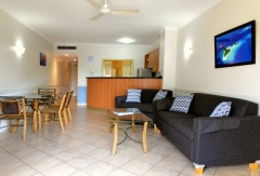 Open plan living, dining and kitchen facilities - Cairns Esplanade Apartments