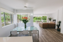 Open plan living looking out to Four Mile Beach, Port Douglas - On the Beach Port Douglas Apartments