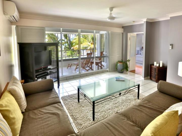Open plan living opening out to private Beachfront Balcony overlooking Palm Cove