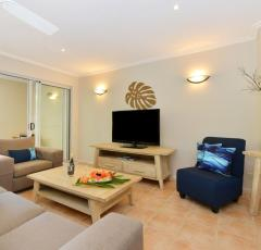 Open plan lounge and dining - Cayman Villas Port Douglas Holiday Apartments