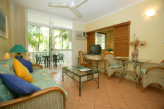 Open plan tropical living area - Port Douglas Coral Apartments