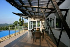 Outdoor Deck and Swimming Pool with stunning views - Mission Beach Luxury Accommodation