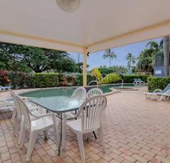 Outdoor Dining by the Pool - North Cove Cairns Esplanade Apartments