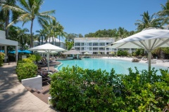 Palm Cove Beach Club Apartments with large Resort Swimming Pool and swim up pool bar