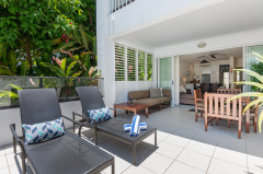 Palm Cove Beach Club Apartments | The spacious Rosemary Two Bedroom Apartment features large patio with sunchairs, and Spa Bath