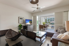 Palm Cove Beach Club Apartments | The spacious Rosemary Two Bedroom Apartment features open plan living flowing out to spacious patio