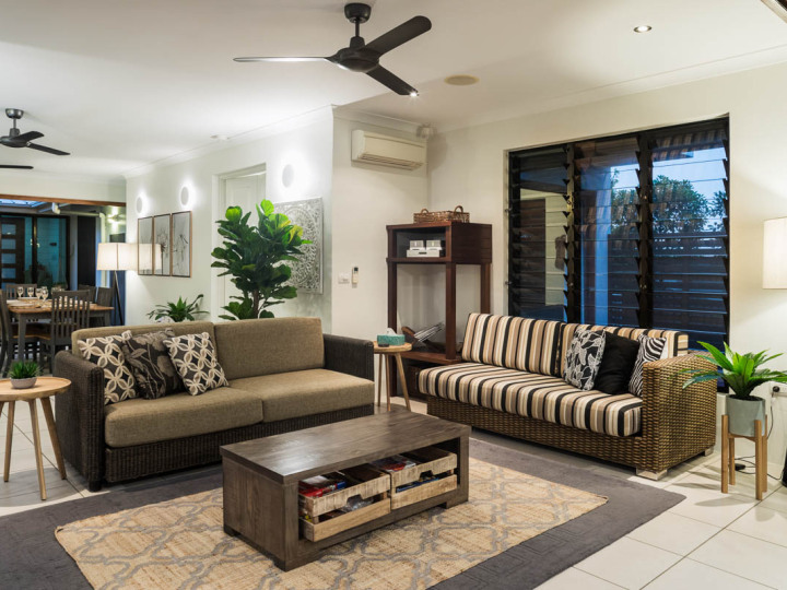 Relax in the open plan living | Palm Cove Holiday Home