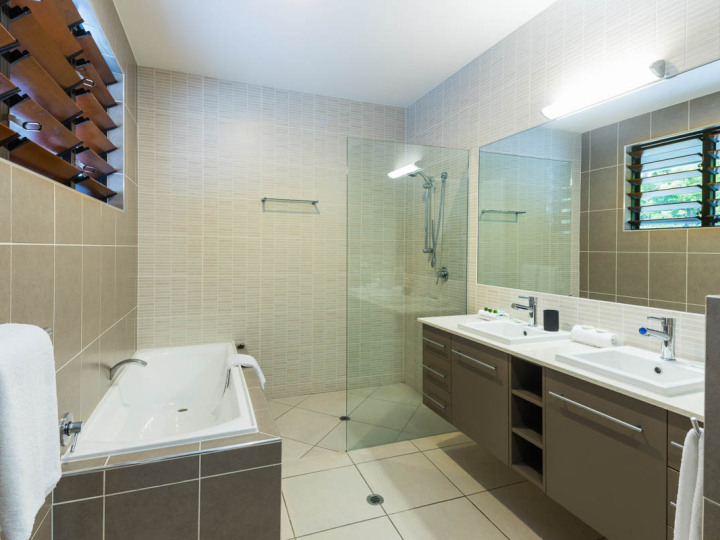 Modern bathroom with bathtub and shower | Palm Cove Holiday Home