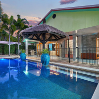 Enjoy your private swimming pool and tranquil gardens - Palm Cove Holiday House