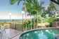 Swim in a pool with views to the Coral Sea and Cairns | Palm Cove Luxury Holiday Home