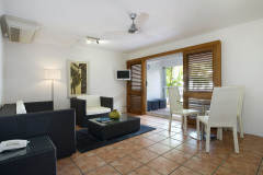 One Bedroom Poolview Suite with separate living area to bedroom with balcony - Paradise On the Beach Resort Palm Cove