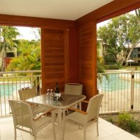 Patio overlooking Pool - Private Palm Cove Holiday Apartment