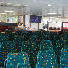 Plenty of seating in the air conditioning | Fitzroy Island Charter