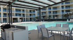 Poolside BBQ facilities - Vue Apartments Trinity Beach