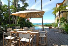 Enjoy the tropical Port Douglas lifestyle with Poolside Dining - Luxury Port Douglas Holiday Home