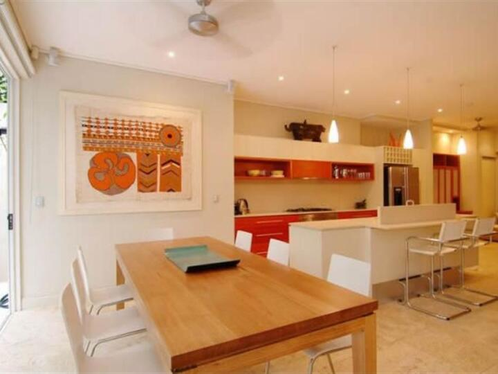 Port Douglas Apartments - Well equipped kitchen and spacious dining opening out to courtyard  Port Douglas Accommodation