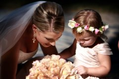 Port Douglas bride and little bridesmaid looking at bouquet