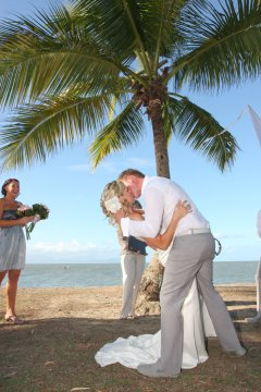 Port Douglas Wedding Couple Kissing after Ceremony on the Beach