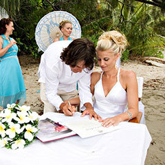 Port Douglas wedding couple signing the marriage certificate