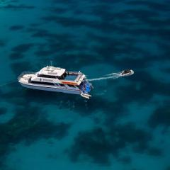 Drone Ariel view of boat on Great Barrier Reef Queensland Australia